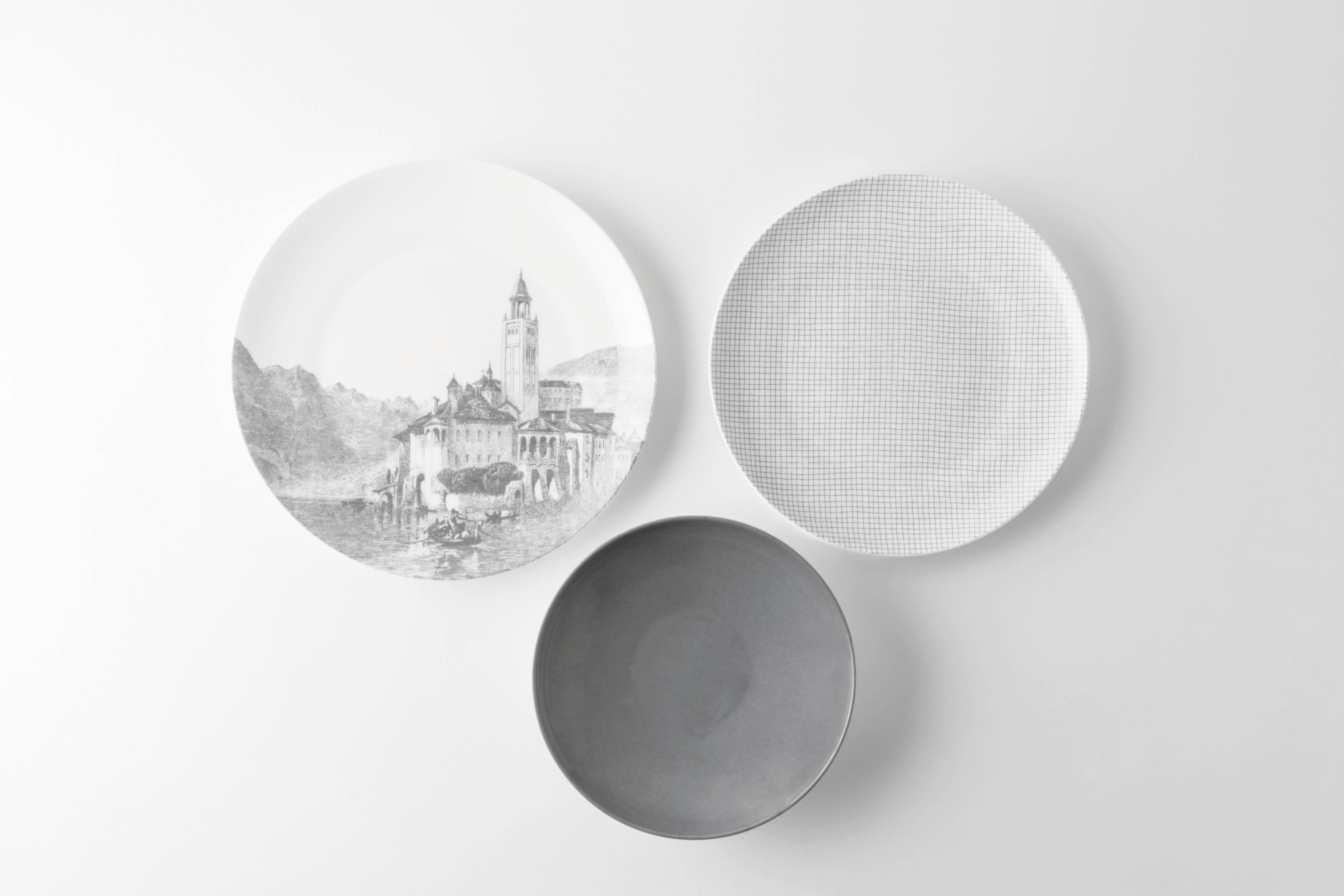 KnIndustrie_Viaggio in ItaliaPaesaggi_ disegnata da Elisa Ossino la collezione rivisita il tema classico dei piatti dipinti con scene di paesaggi evocativi e